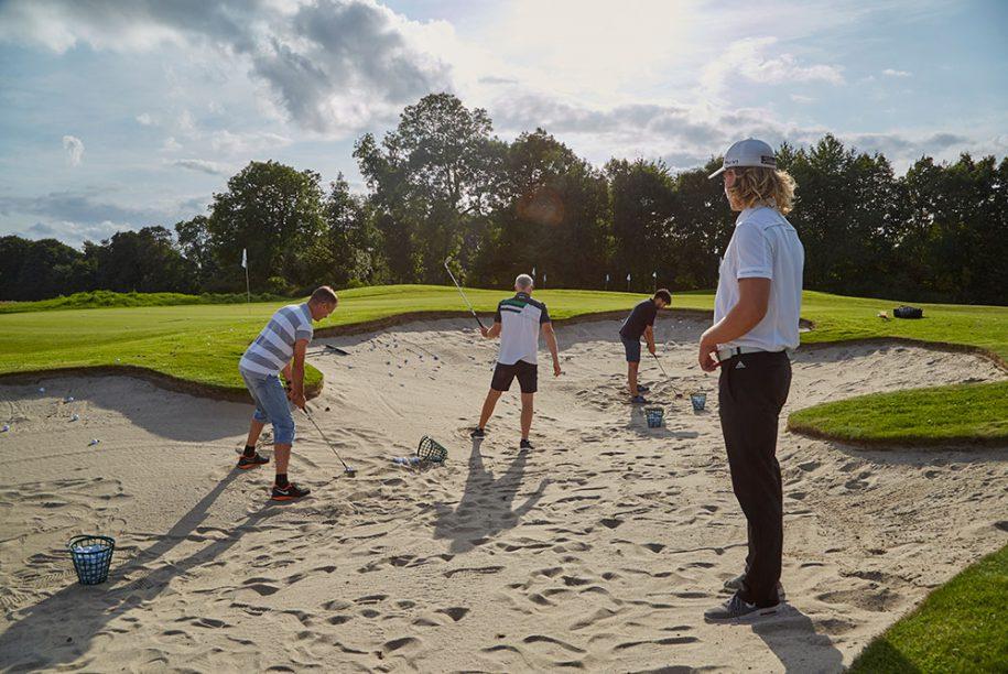 Golf underviser i sand